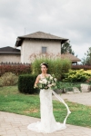 Lasting Events- bride outside Rockway Vineyard with white floral bouquet