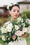 Lasting Events- white and green bridal bouquet held by bride