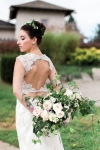 Lasting Events- bride hold white and green bouquet behind back