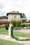Lasting Events- bride outside Rockway Vineyard with long green garland wrapped around