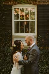 bride and groom smiling with excitement during first look