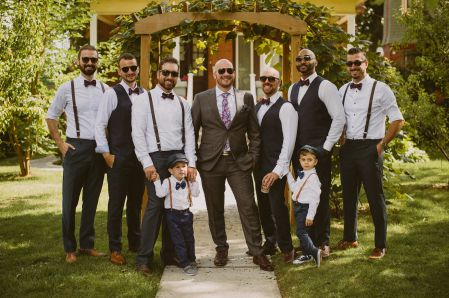 Groom and groomsmen group shot outside of air bnb
