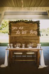 sweetheart table with wooden backdrop you are the best thing