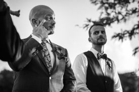 groom sheds a tear as bride walks down aisle