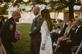 officiant, bride and groom laughing during ceremony