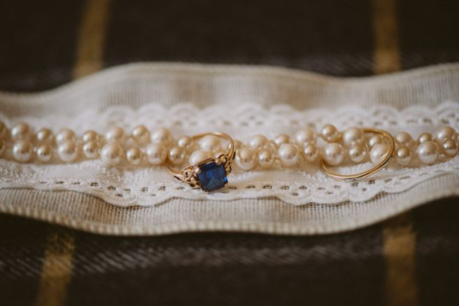 rings and pearls on fabric to surprise bride