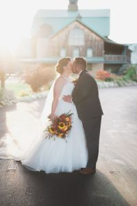 Lasting Events- bride and groom kissing outside Hernder Estate Winery