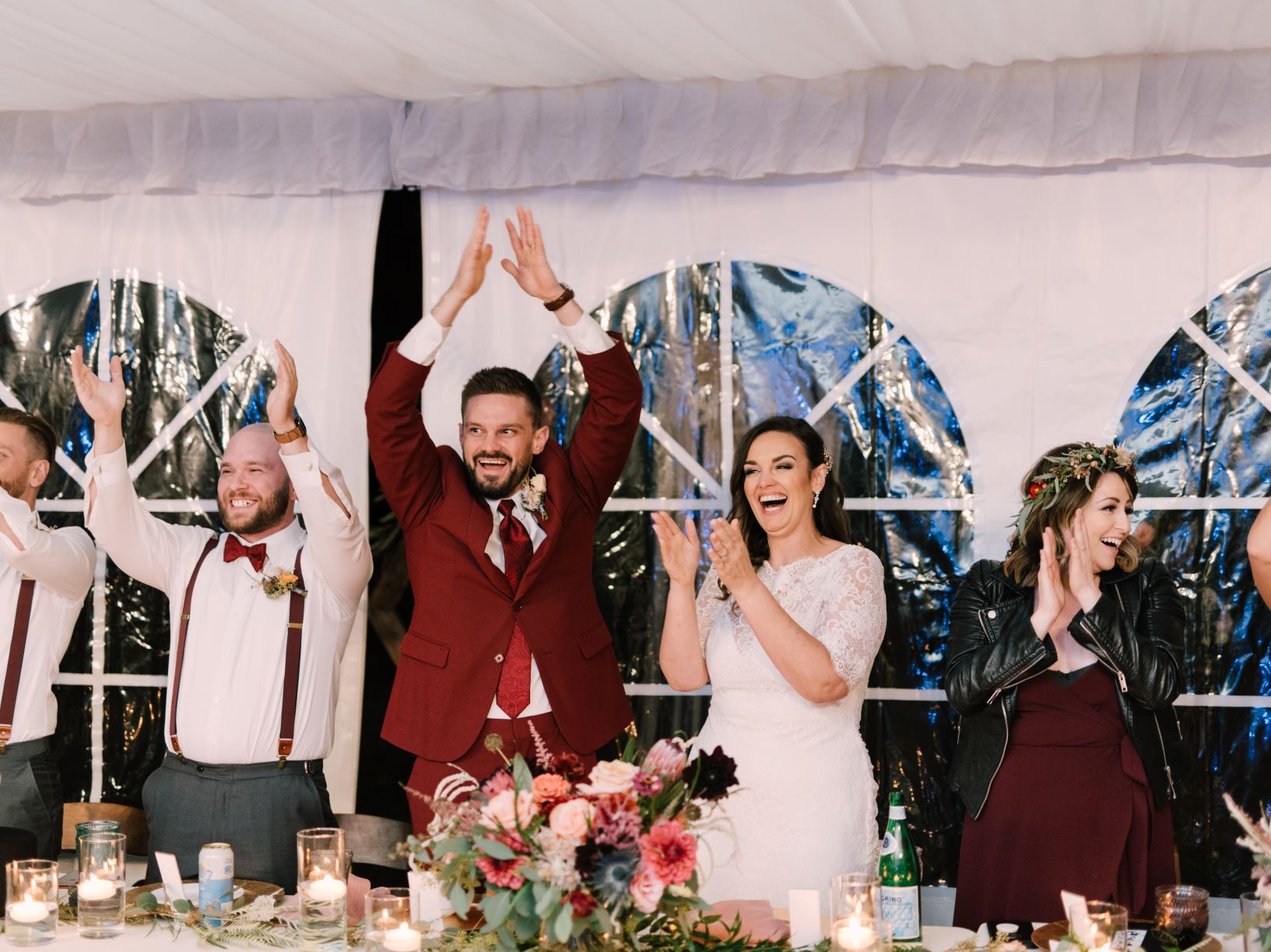 bride and groom laughing at tented wedding
