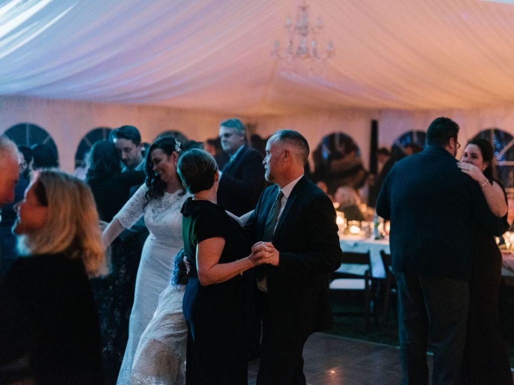 Guests dancing at tented wedding in Niagara