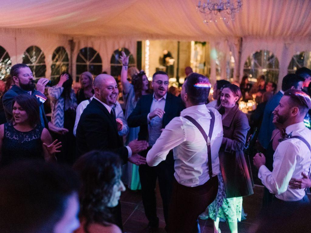 Guests dancing at tented wedding at Rodman Hall St. Catharines