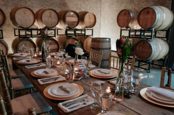 Guest harvest table in the Barrel Room at The Hare Wine Co