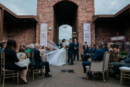 wedding ceremony in the Courtyard at The Hare Wine Co in Niagara-on-the-Lake