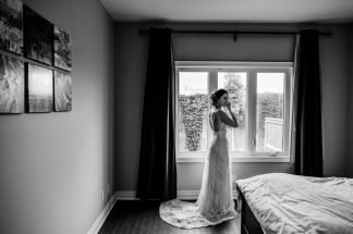 Bride putting on finishing touches before wedding day