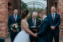 Wedding ceremony lead by bride's father in the Courtyard at The Hare Wine Co
