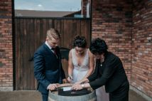 Bride & groom signing marriage license at The Hare Wine Co