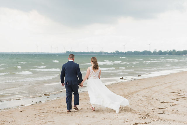Niagara beach wedding bride and groom walk along beach