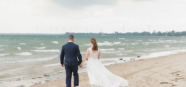 Niagara beach wedding bride and groom walk along beach