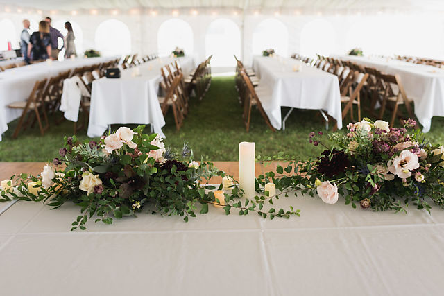 Niagara tented wedding flowers on head table
