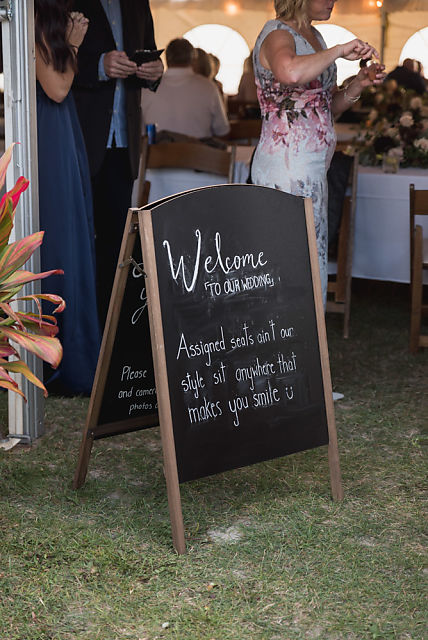 Welcome sign at wedding telling guests there is no seating plan