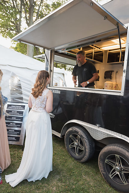 Bride lining up to be served by The Smokin' Buddha food truck