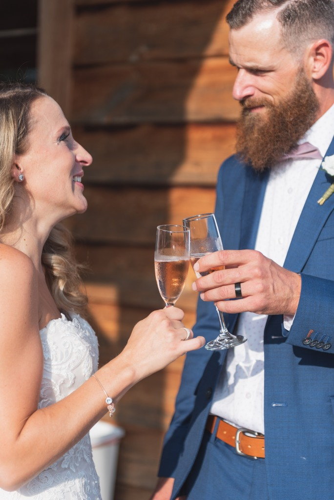 bride and groom cheers after their wedding ceremony at Stonewall Estates Winery
