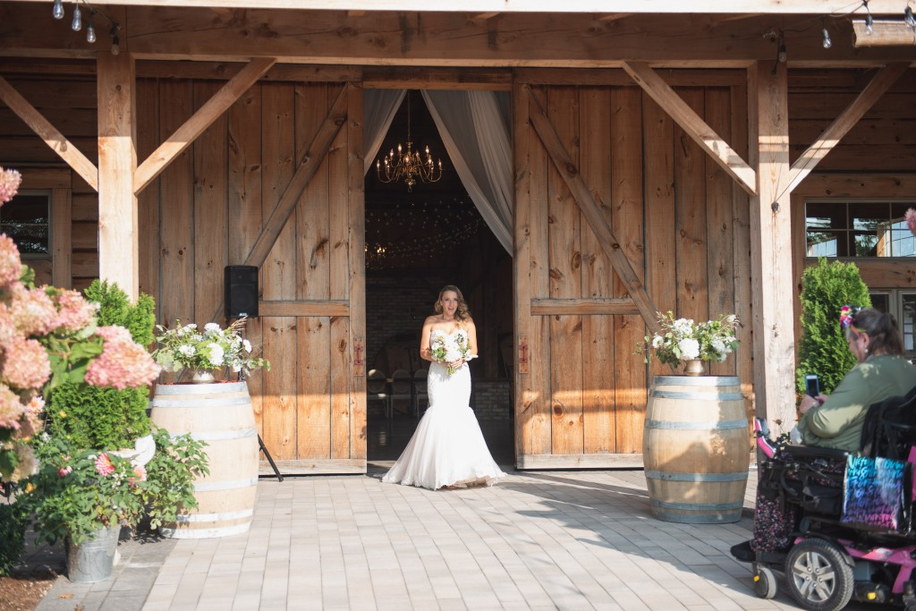 bride coming down the aisle at Stonewall Estates Winery pop up wedding