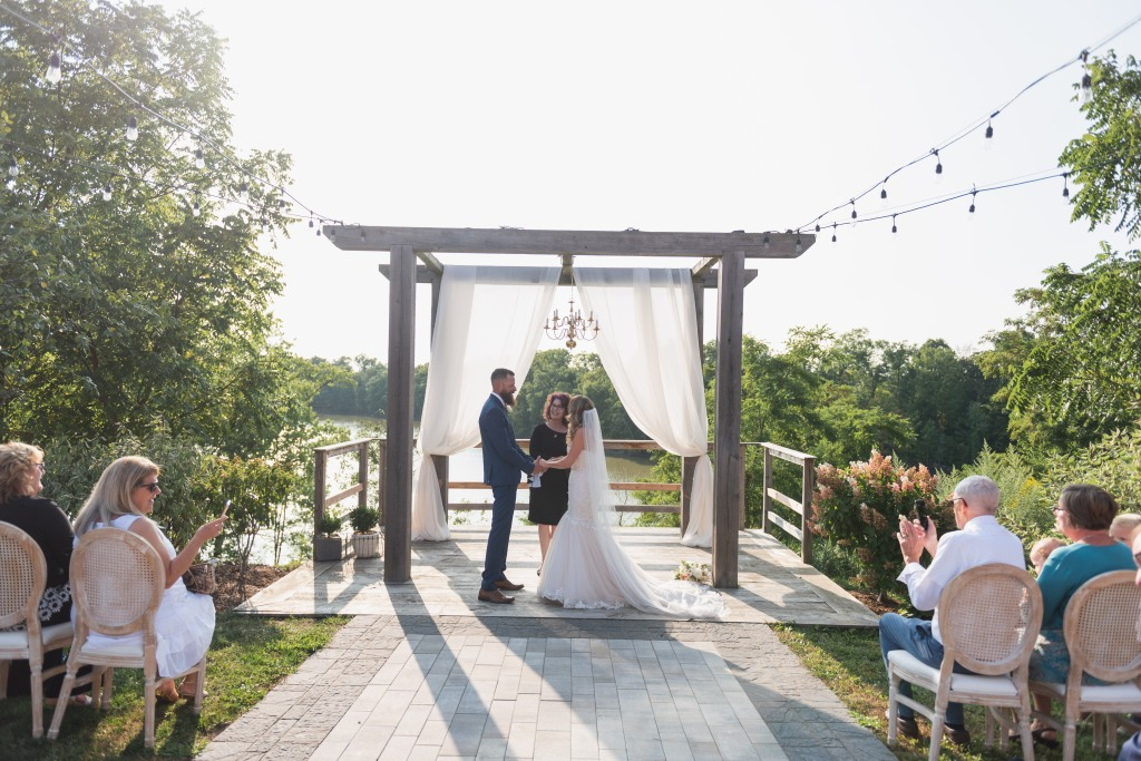 bride and groom during the ceremony at the alter at Stonewall Estates
