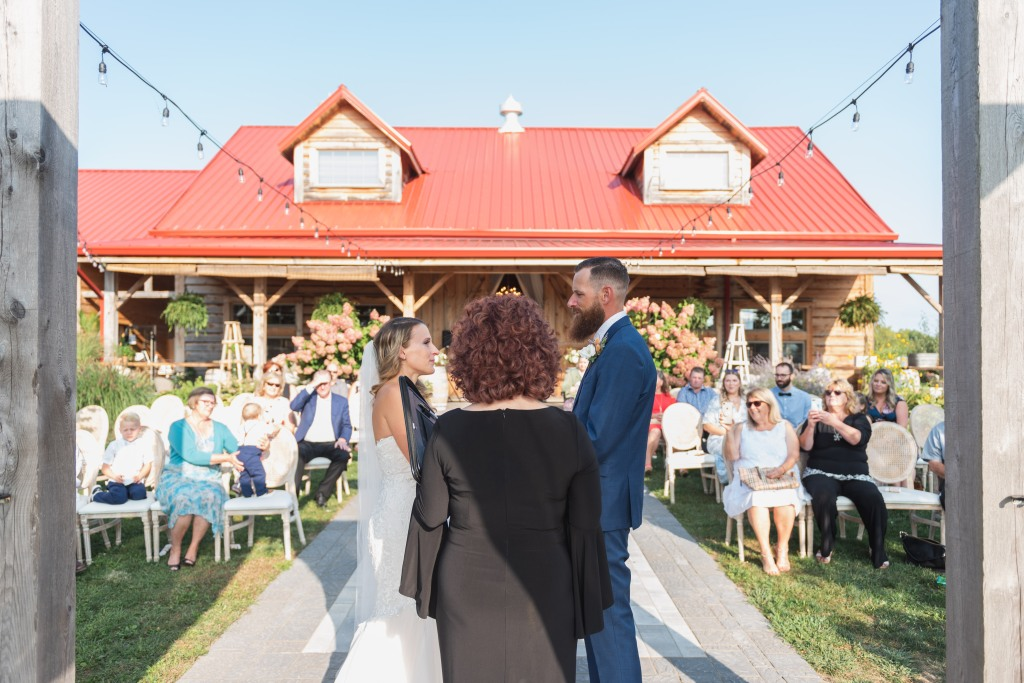 view of guests during ceremony from behind officiant at Stonewall Estates