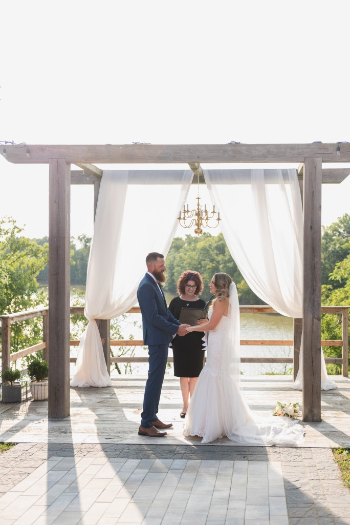 bride, groom and officiant during wedding ceremony