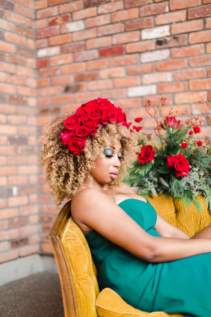 Model in green dress and red floral crown in Niagara-on-the-Lake