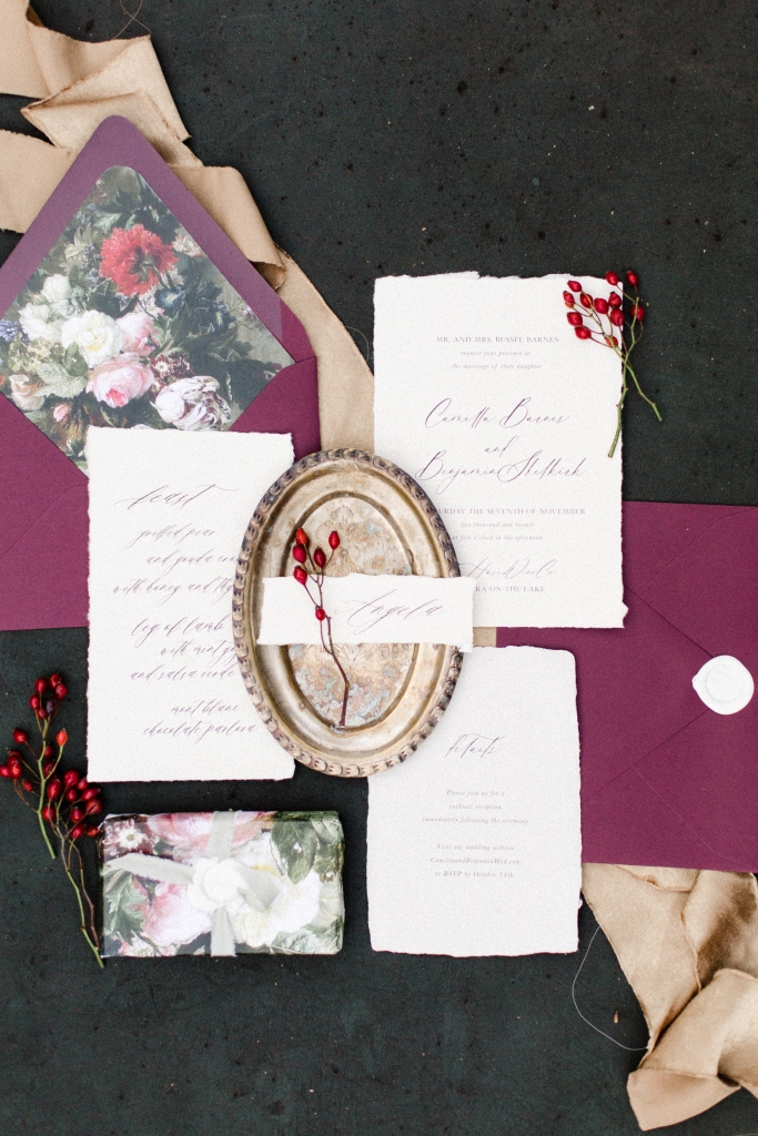 Red and white stationery flatlay by StatueRue