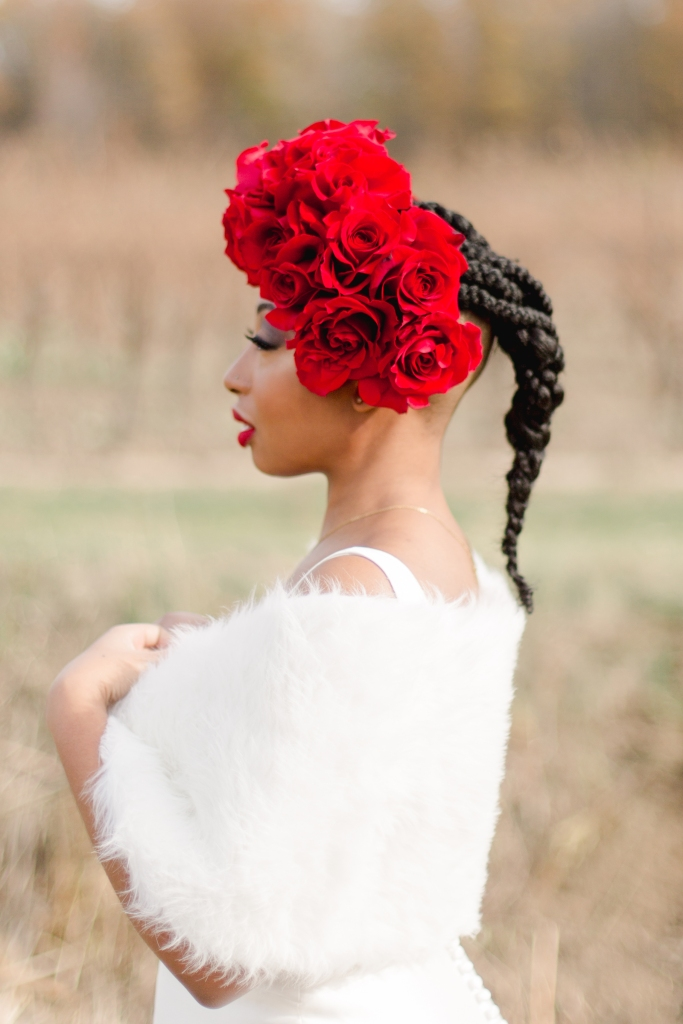 Bride side profile with red rose floral crown at Niagara-on-the-Lake Winery