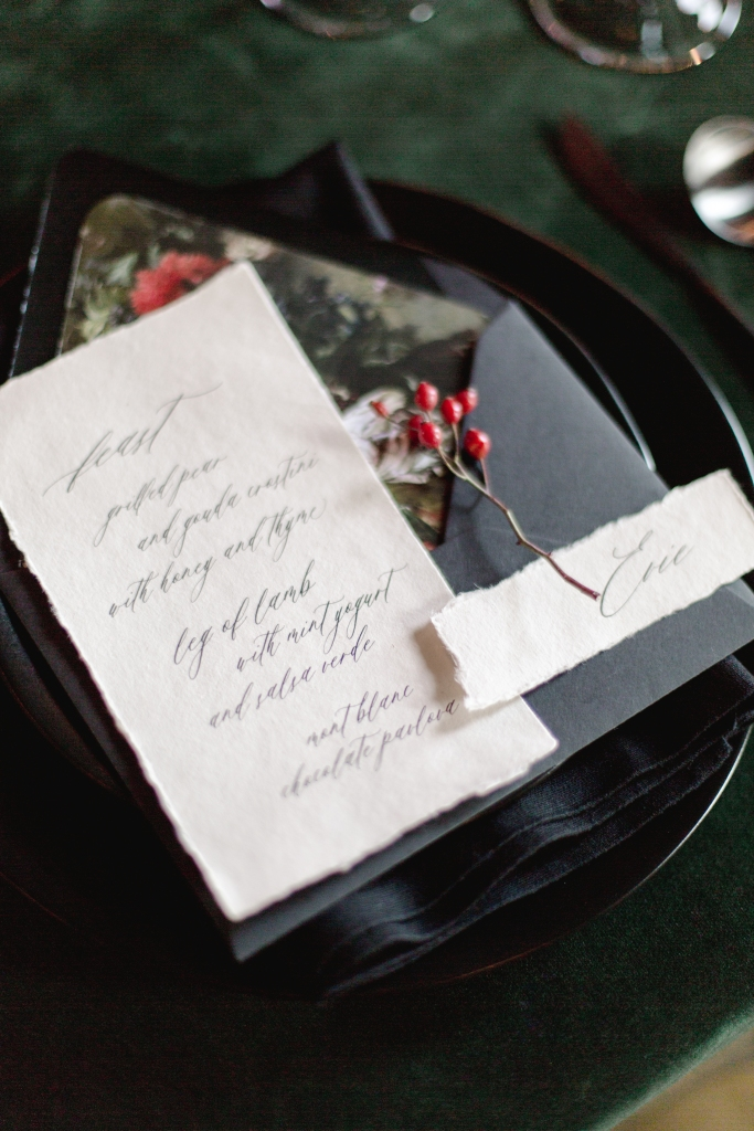 Close up of wedding menu and place setting by Statue Rue