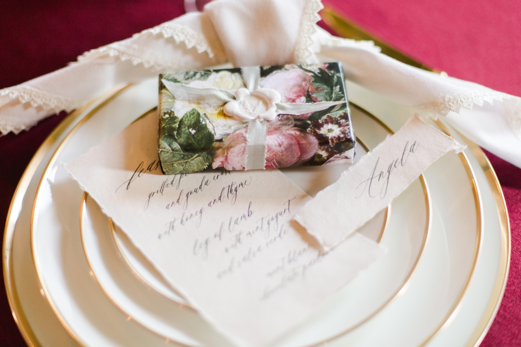 Close up of wedding day menu and place setting by StatueRue
