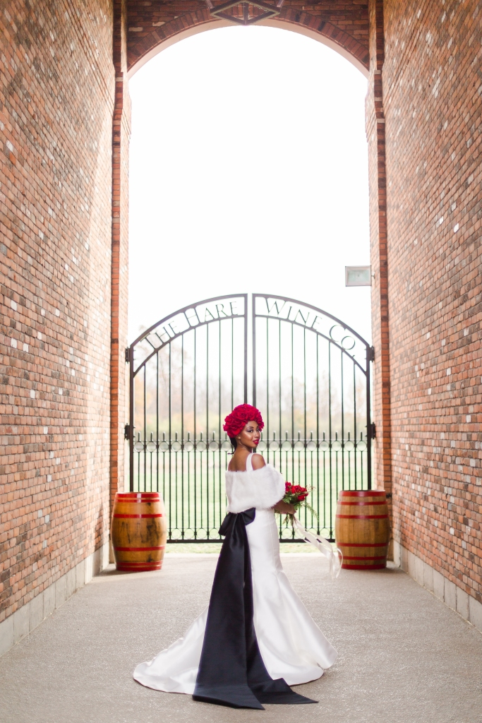Bride in brick archway at The Hare Winery in Niagara-on-the-Lake