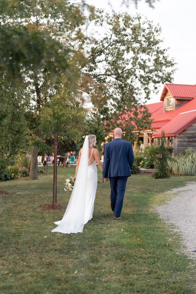 couple walking towards ceremony at Stonewall Estates in Niagara