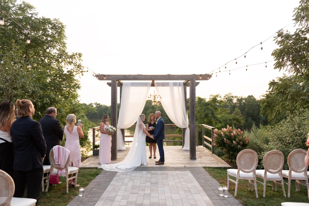 the wedding ceremony at sunset at Stonewall Estates in Niagara