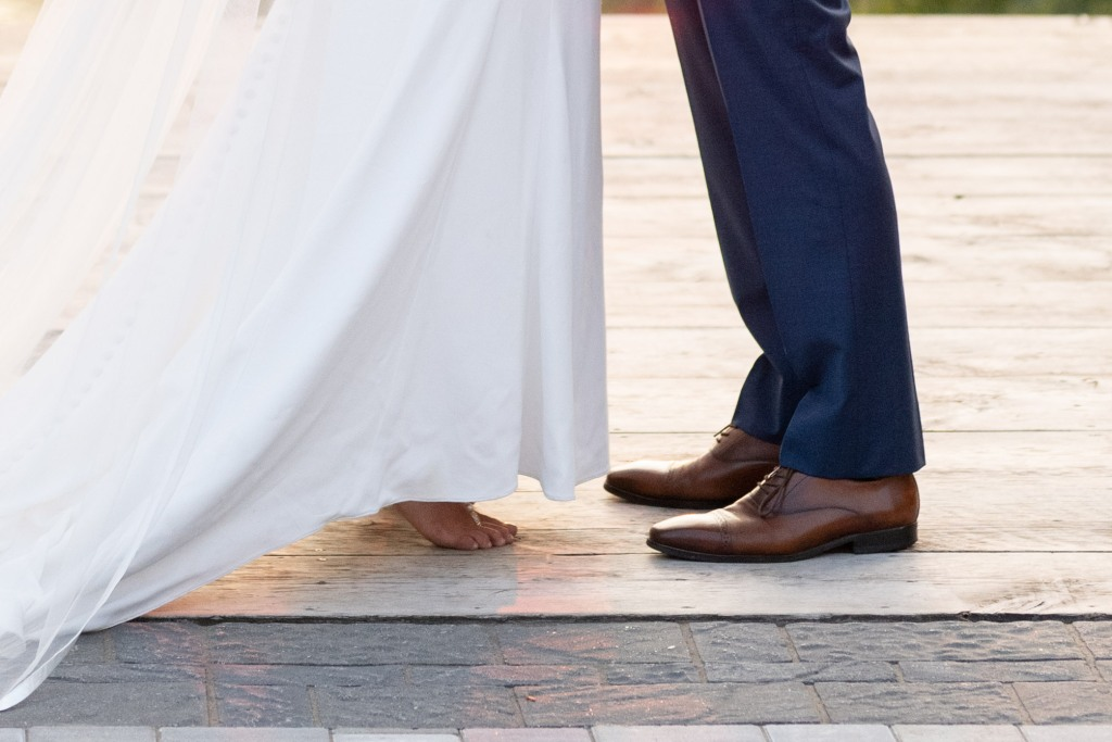 Bride and groom's feet- bride in bare feet