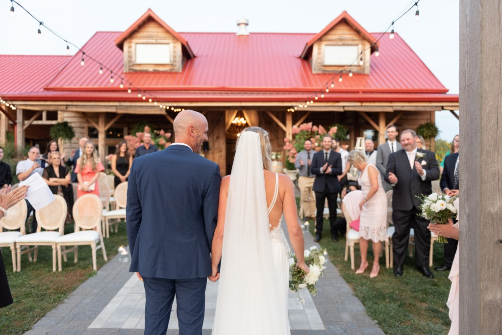 The couple looking at guests at the end of the ceremony at Stonewall Estates in Niagara