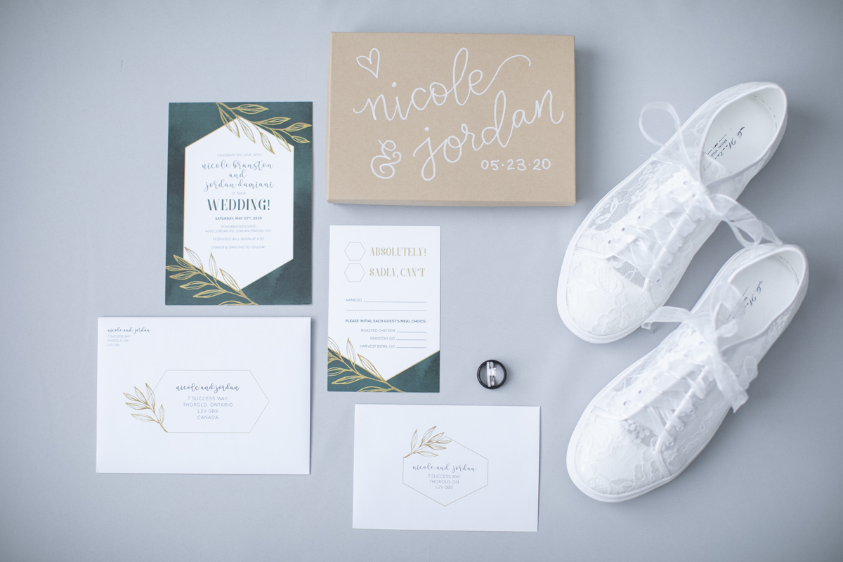 Wedding stationery in green and white with brides lace sneakers