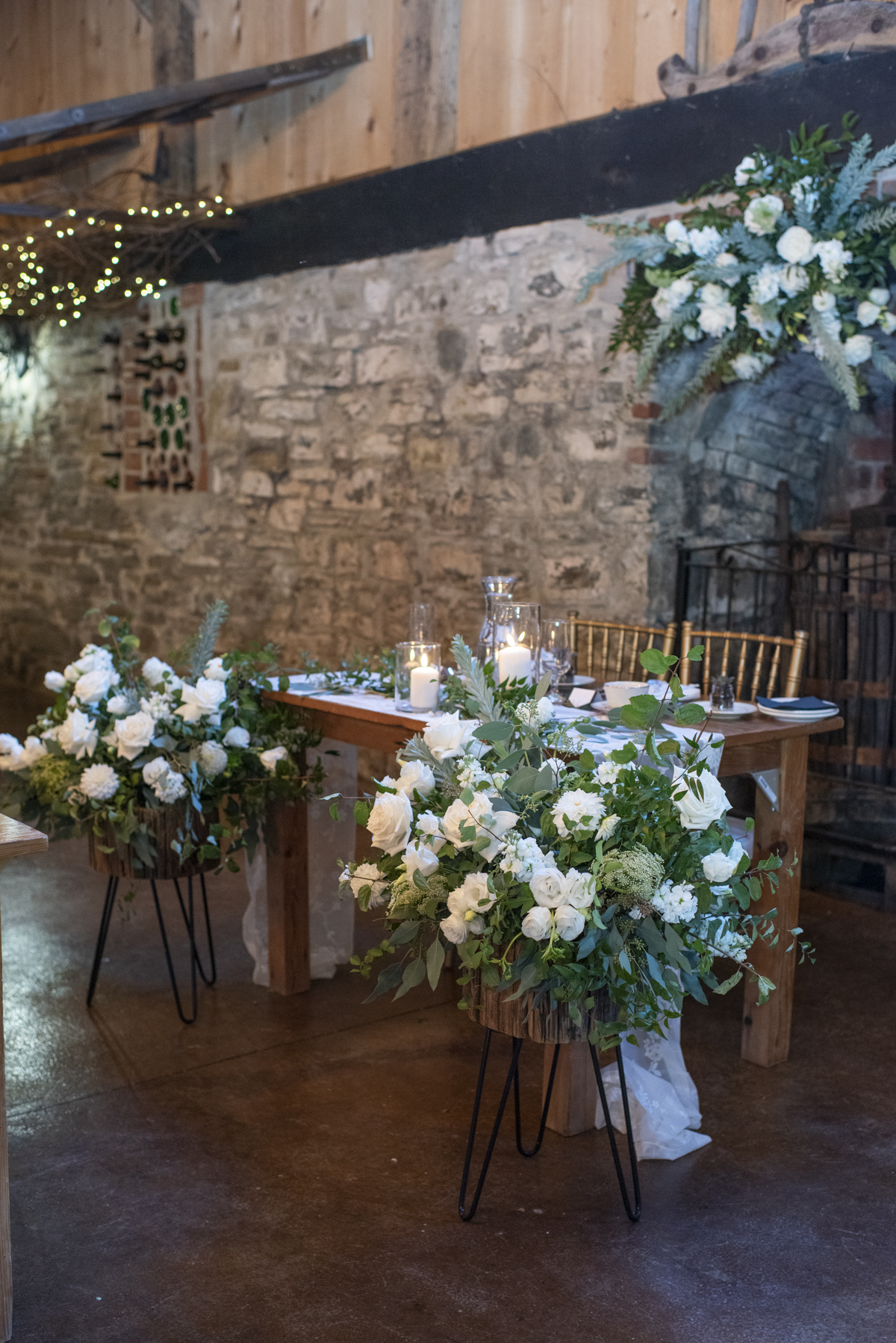 Sweetheart table surrounded by white and green flowers