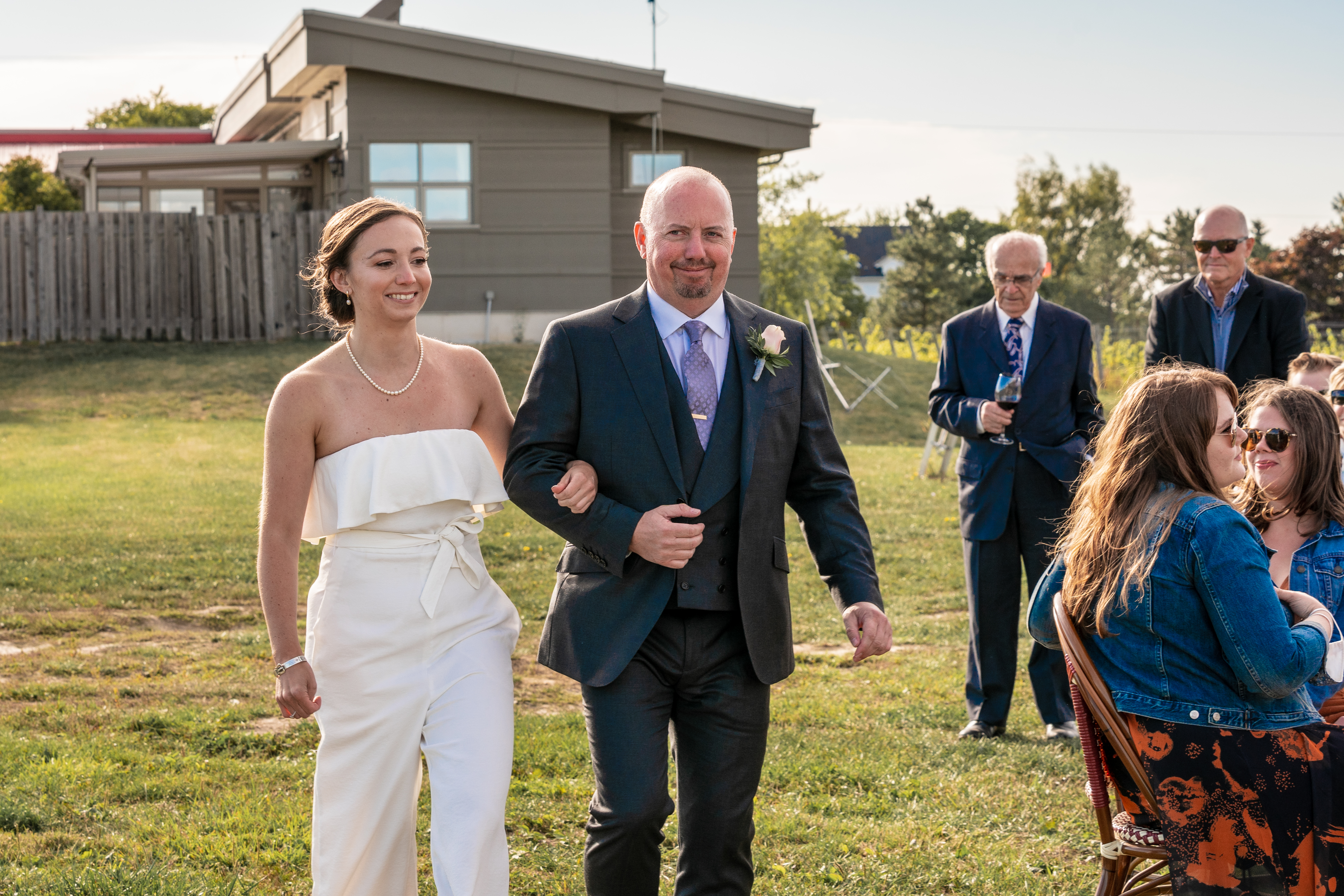 Bride and her dad walk down aisle