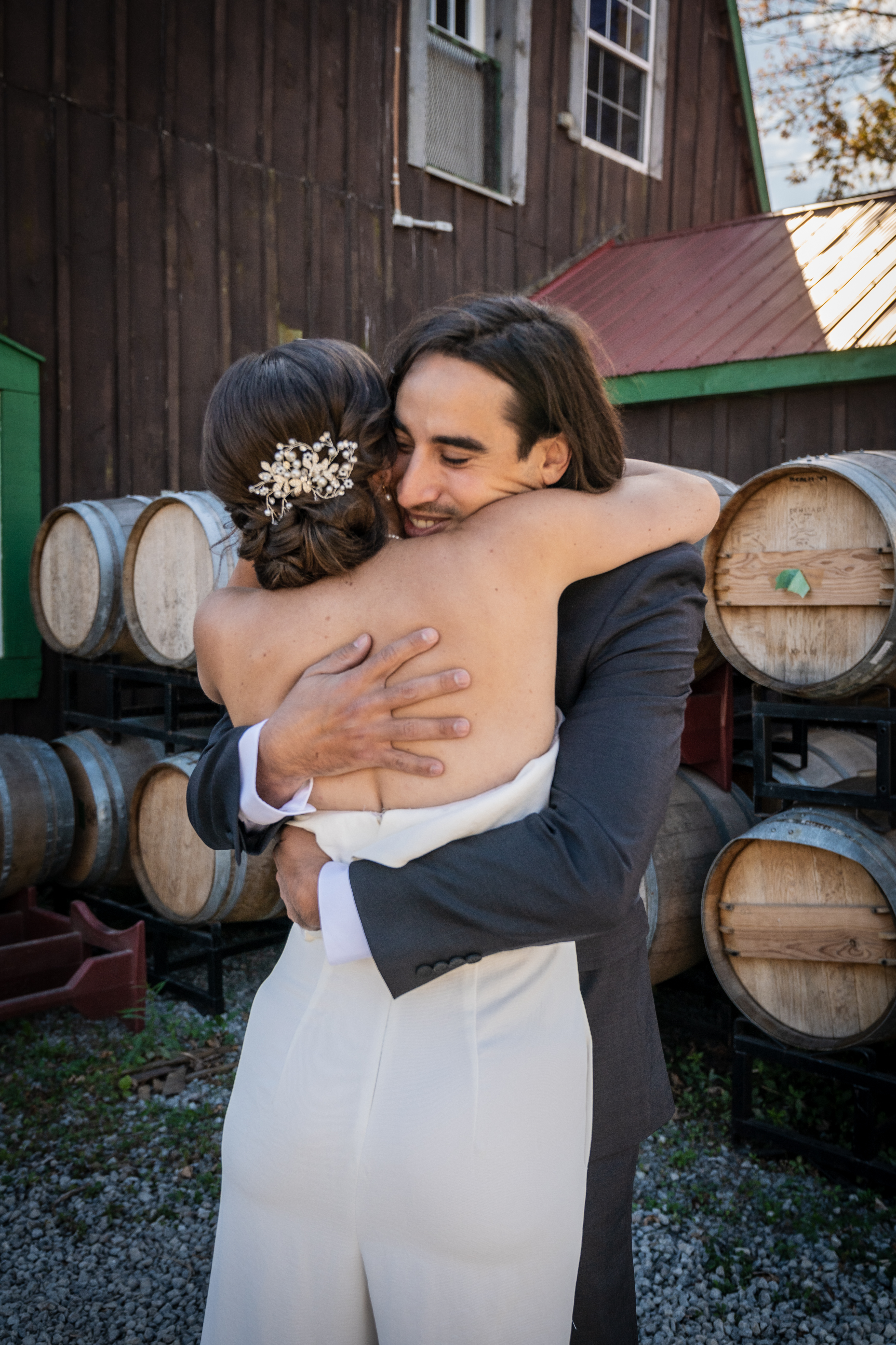 Bride and groom share a hug at London Born Wine Co
