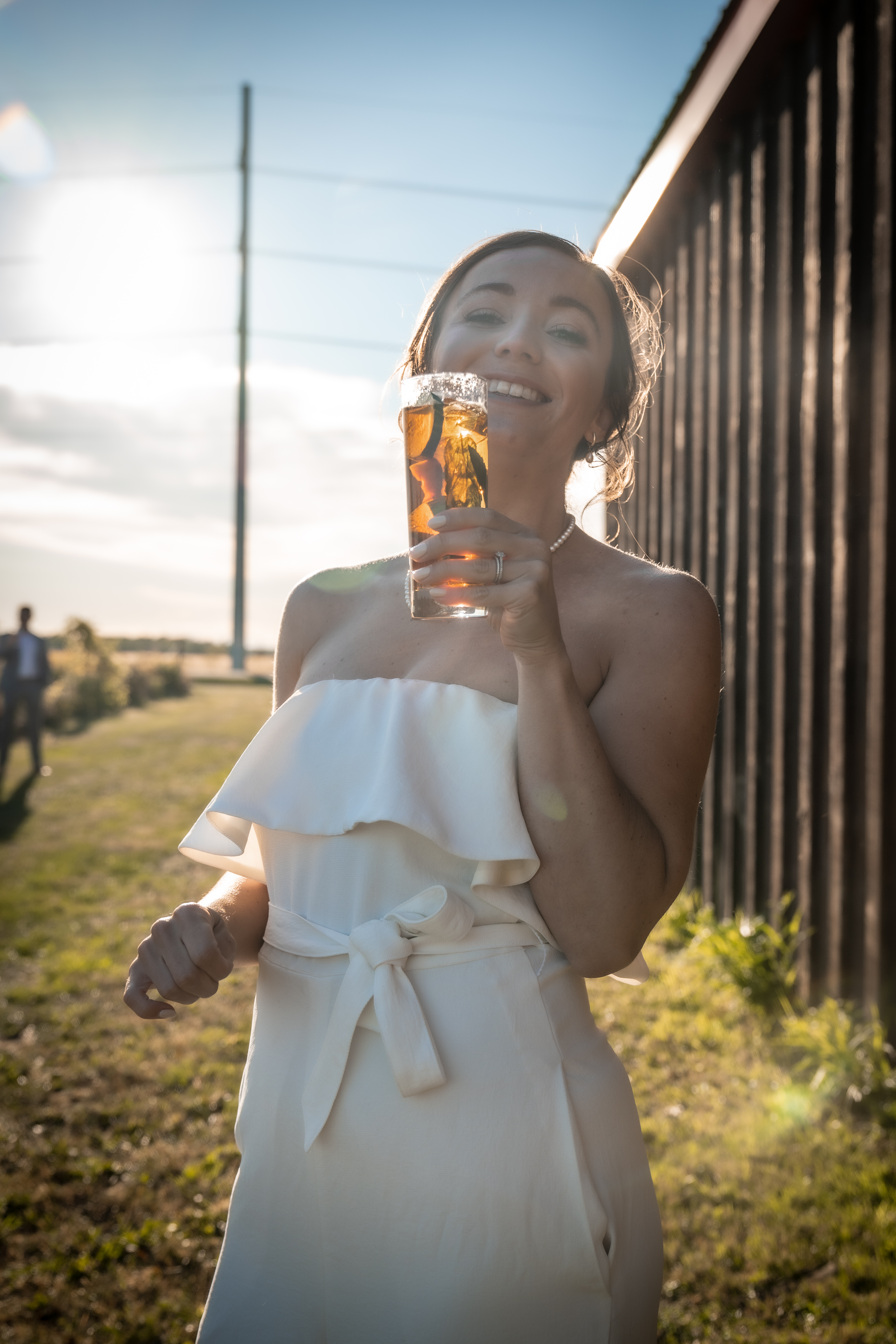 Bride enjoying a Pimms during cocktail hour