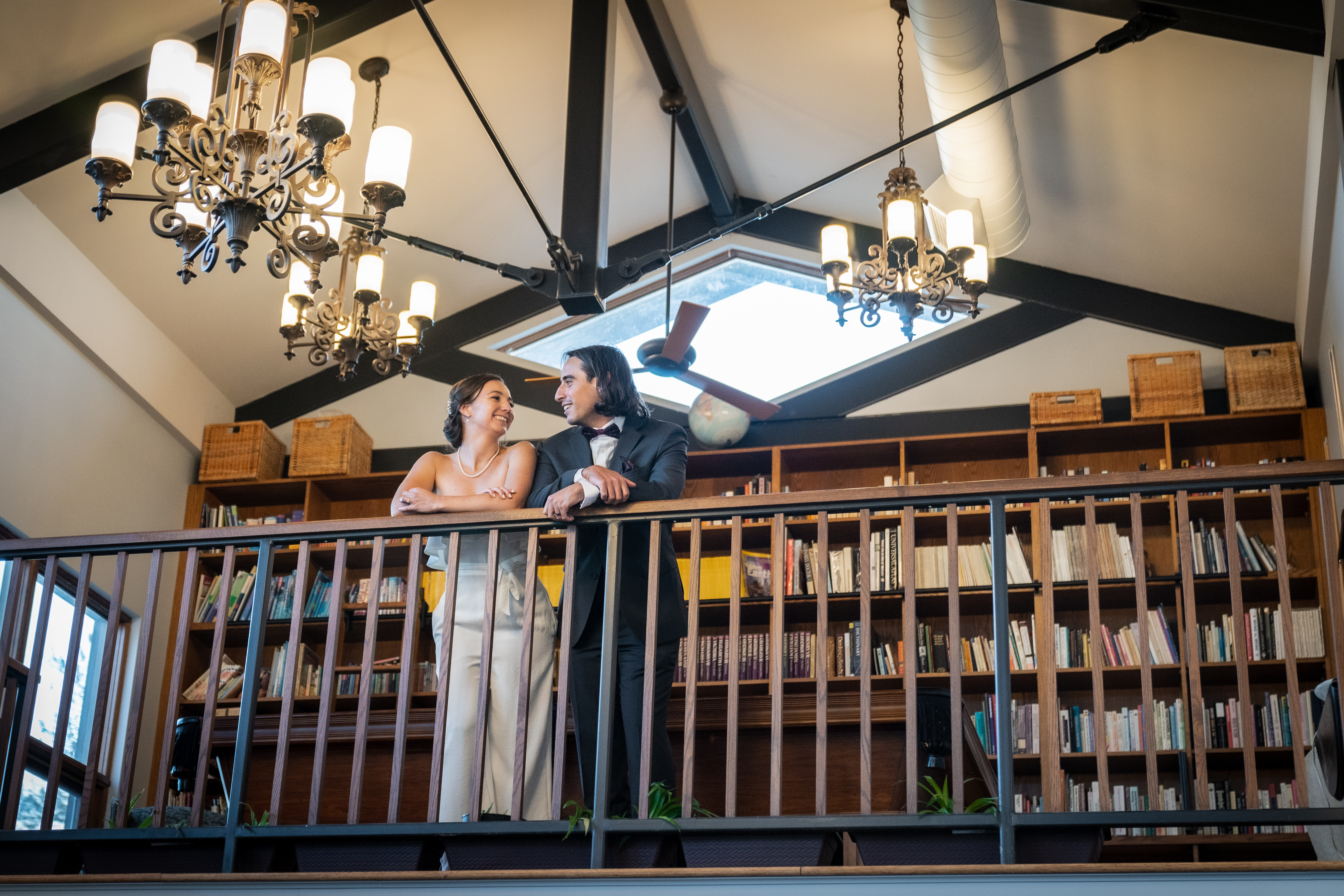 Bride and groom at library balcony at London Born Wine Co