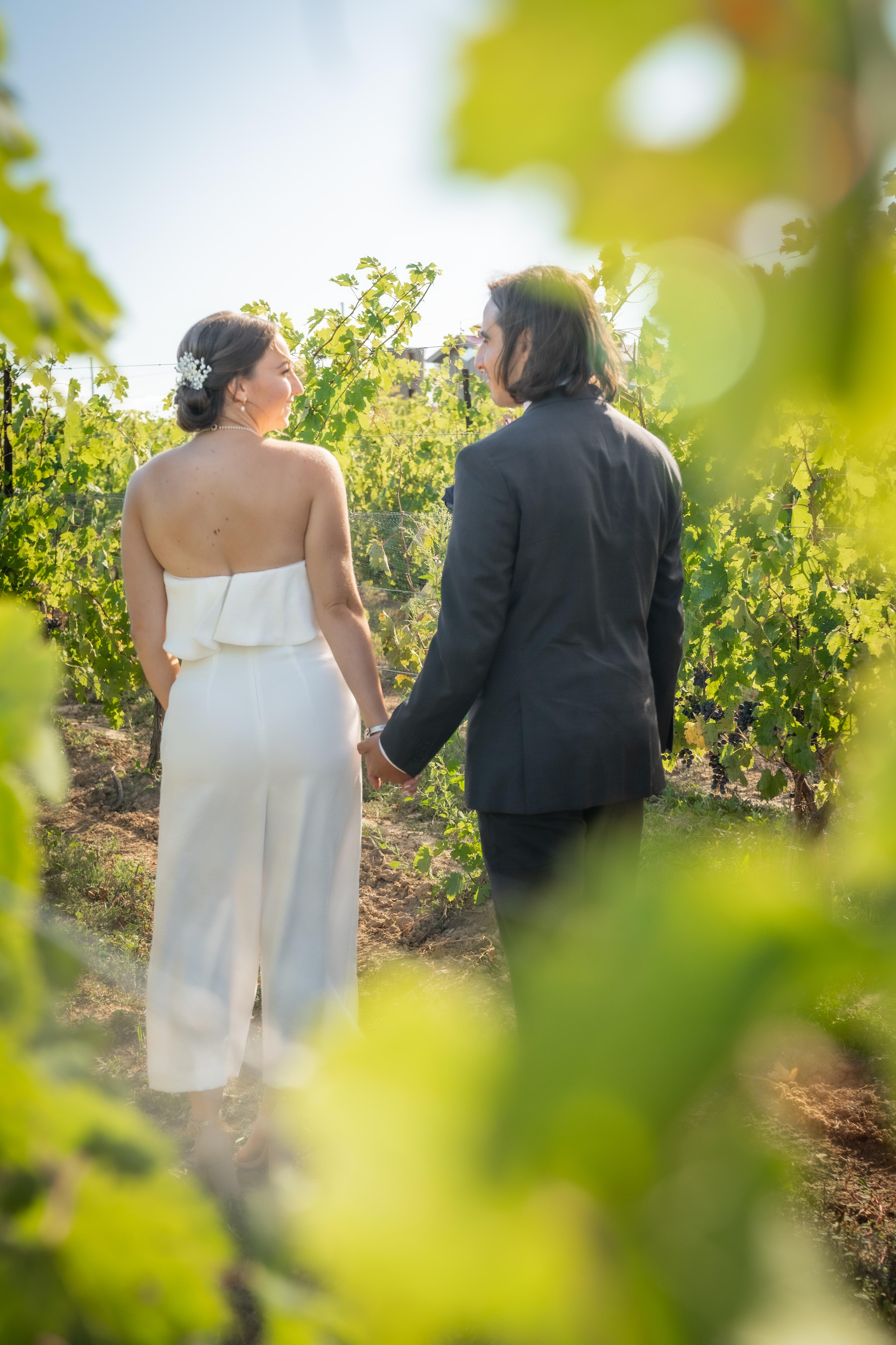 Bride and groom in vineyard before wedding ceremony