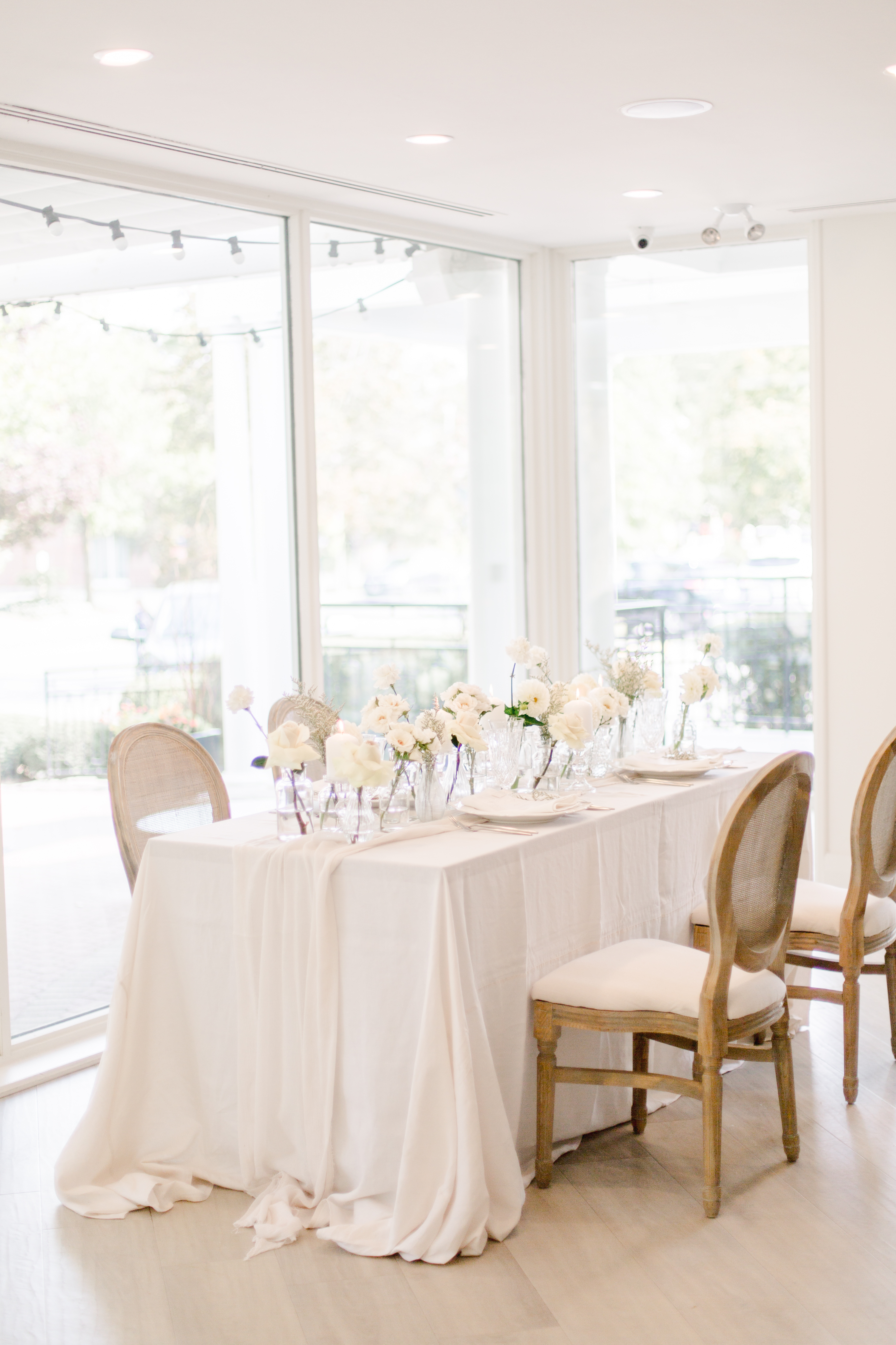 Wedding table in front of floor to ceiling windows at The Gate House in Niagara-on-the-Lake