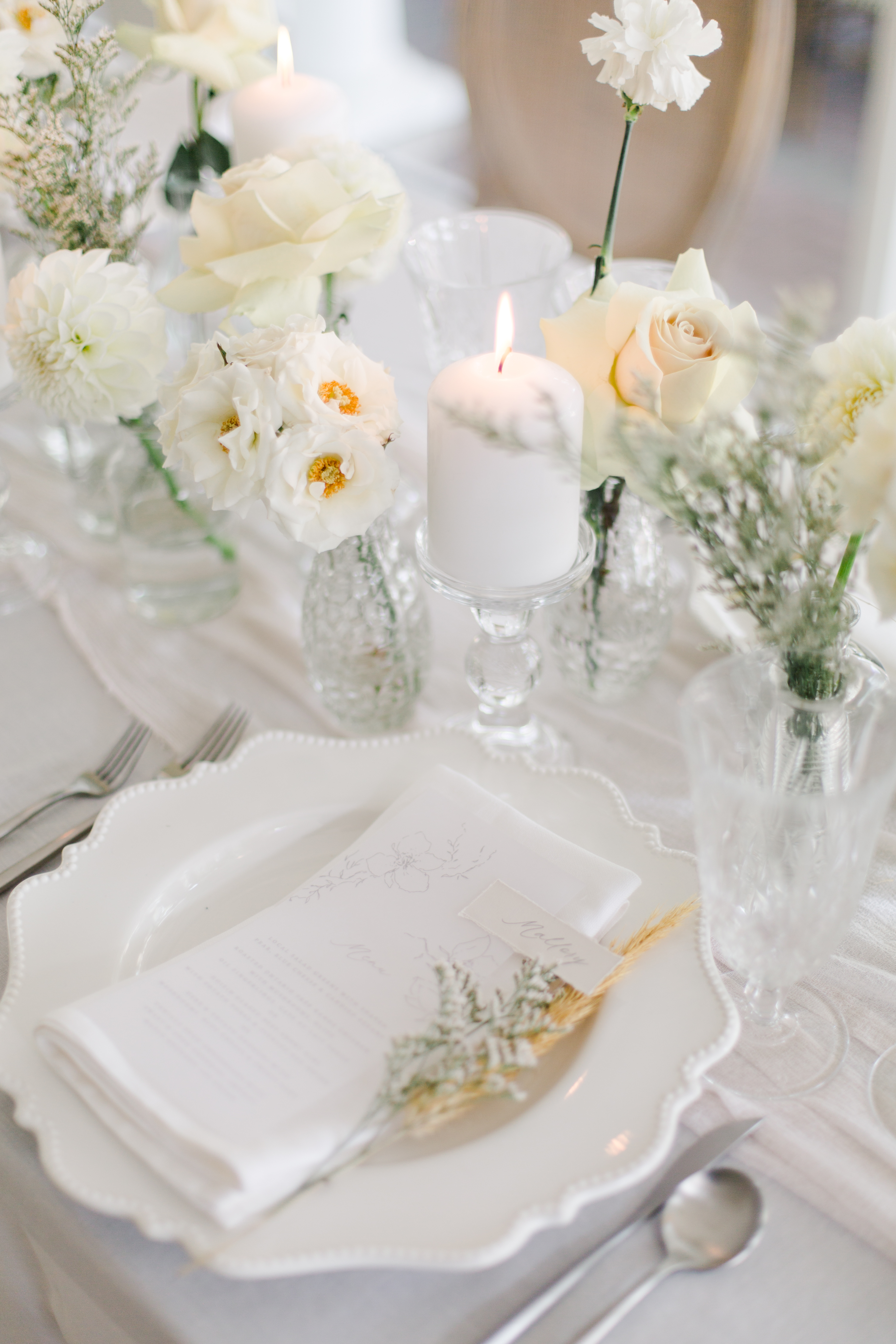 All white wedding guest place setting
