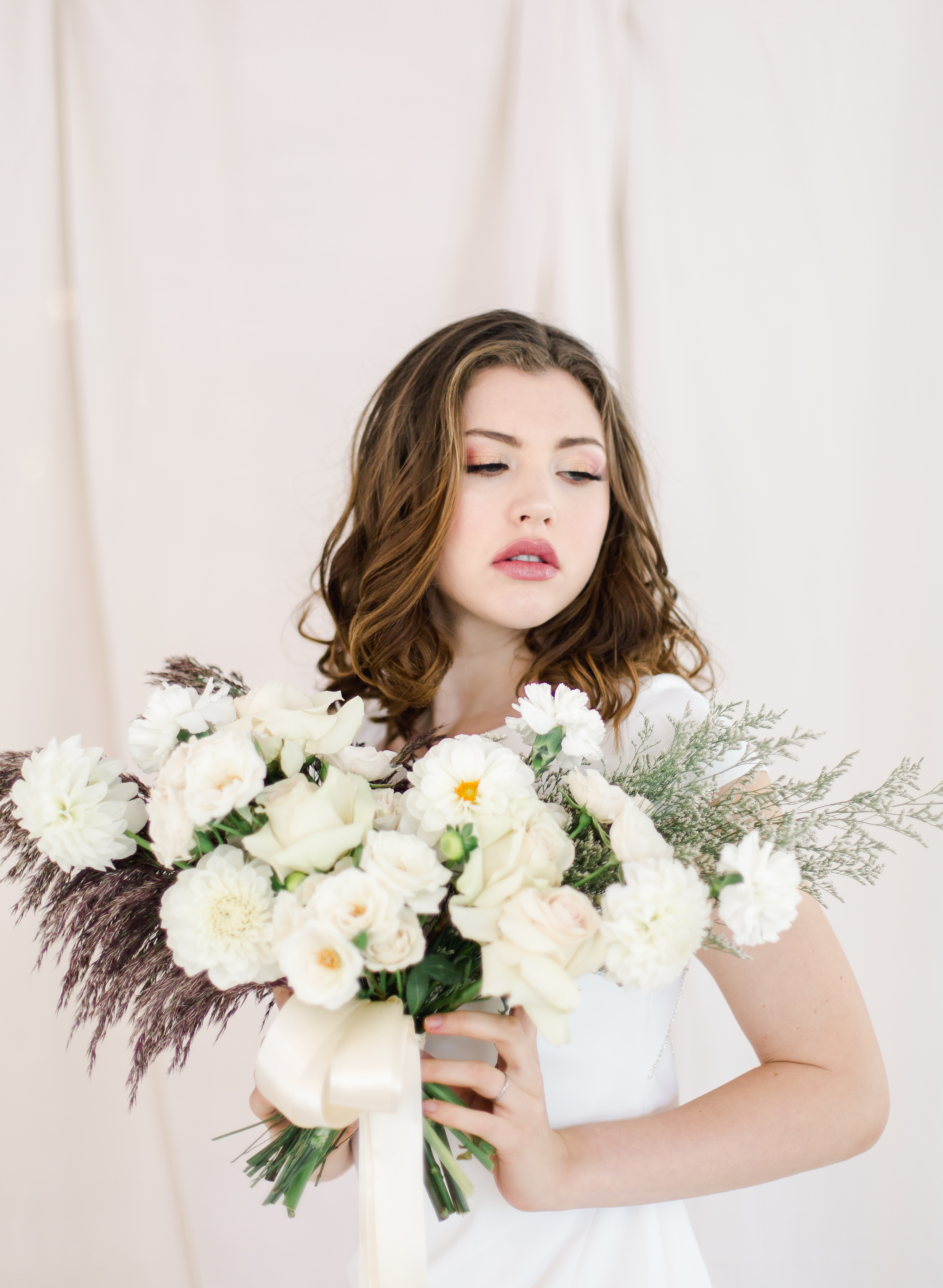 Bride with organic, all white bridal bouquet
